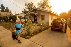 As the Dixie Fire burns towards Susanville, Calif., Gary Mooney prepares to evacuate from his home on Monday, Aug. 16, 2021. (AP Photo/Noah Berger)