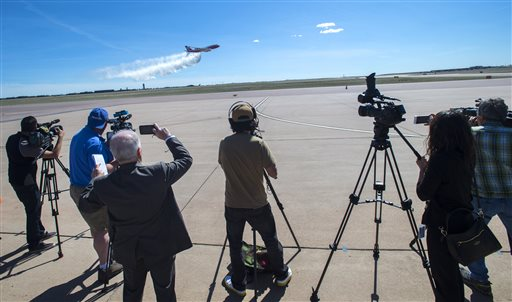 The Boeing 747-400 Global SuperTanker drops half a load of itÂ's 19,400-gallon capacity during a ceremony Thursday, May 5, 2016, at the Colorado Springs, Colo., Airport demonstrating the firefighting capabilities of the worldÂ's largest firefighting plane. The Spirit of John Muir plane will be stationed out of the Colorado Springs Airport and will be able to respond to fires around the world.  (Christian Murdock/The Gazette via AP)