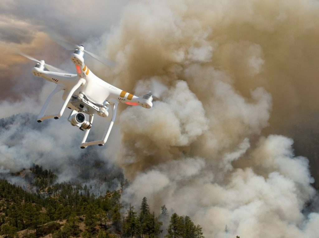A drone flying over a wildfire. (Bureau of Land Management photo)