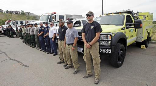 Wildfire crews look on after wildfire agencies laid out their preparation and expectation for the wildfire season in Utah Thursday, June 9, 2016, in Salt Lake City. Utah's wildfire season has been relatively mild so far this year but state officials said Thursday that the state is primed to burn more than in 2015. A wet winter and spring delivered needed moisture to forests in canyons and higher elevations, but it also caused more grass to grow in valleys, said Basil Newmerzhycky, a fire weather meteorologist with the U.S. Bureau of Land Management. (AP Photo/Rick Bowmer) Wildfire crews look on after wildfire agencies laid out their preparation and expectation for the wildfire season in Utah Thursday, June 9, 2016, in Salt Lake City. Utah's wildfire season has been relatively mild so far this year but state officials said Thursday that the state is primed to burn more than in 2015. A wet winter and spring delivered needed moisture to forests in canyons and higher elevations, but it also caused more grass to grow in valleys, said Basil Newmerzhycky, a fire weather meteorologist with the U.S. Bureau of Land Management. (AP Photo/Rick Bowmer)