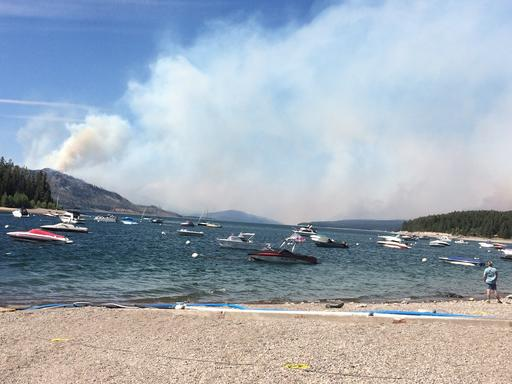 Smoke fills the sky in a view north toward Yellowstone National Park from Leeks Marina in Moose, Wyo., on Tuesday, Aug. 23, 2016. Visitors headed north are being stopped at Leeks. In neighboring Yellowstone, a fire grew near West Entrance Road. A team of fire managers was being brought in to help, although the fire was not yet being actively suppressed. (AP Photo/Dave Zelio)