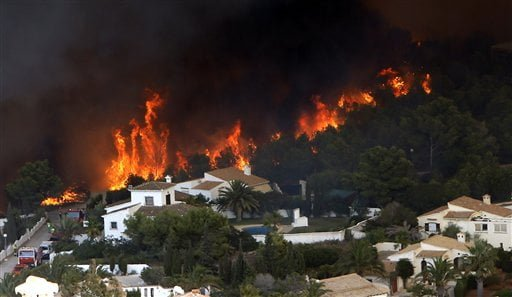 A wildfire burns nearby Benitachel village, eastern Spain, Monday, Sept. 5, 2016. Spanish firefighters are still working to bring under control a forest blaze near Valencia that forced the evacuation of around 1,000 people. Authorities said more than 200 firefighters with 65 vehicles were deployed Monday to the wildfire some 350 kilometers (220 miles) southeast of Madrid. (AP Photo/Alberto Saiz)