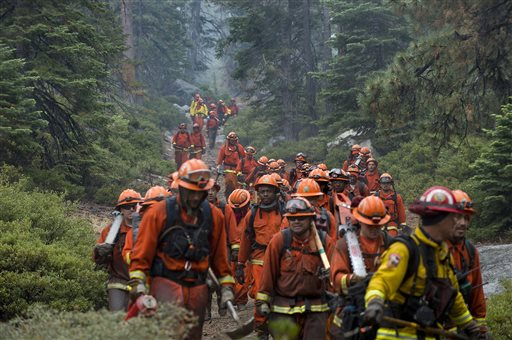 Hand crews finish up work on the Emerald Fire along Highway 89, Friday, Oct. 14, 2016 on the southwest shores of Lake Tahoe. The blaze that burned about 200 acres northwest of South Lake Tahoe, California was one of three wind-whipped wildfires burning along the Sierra Nevada. The largest one destroyed more than 20 homes in a rural valley between Carson City and Reno, Nevada. (Randall Benton/The Sacramento Bee via AP)