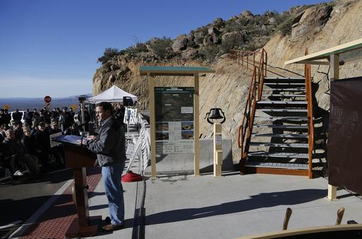 Arizona Republican Gov. Doug Ducey officially dedicates the new Granite Mountain Hotshots Memorial State Park as a tribute to the 19 firefighters killed during a 2013 wildfire in a ceremony Tuesday, Nov. 29, 2016, in Yarnell, Ariz. Ducey said the 3-mile trail and memorial would serve as a lasting tribute to the fallen firefighters' heroism. (AP Photo/Ross D. Franklin)