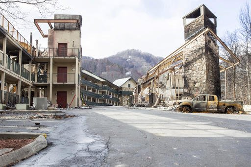 Fire damage to the Laurel Point Resort in Gatlinburg, Tenn., is seen on Friday, Dec. 9, 2016. Gatlinburg reopened to the public for the first time since fatal wildfires spread to the city on Nov. 28. (AP Photo/Erik Schelzig)