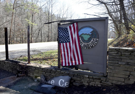 An American flag has been hung at the entrance to Gatlinburg , Tenn., Thursday, Dec. 1, 2016. A devastating wildfire destroyed numerous homes and buildings on Monday. (Michael Patrick/Knoxville News Sentinel via AP)