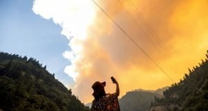 Jessica Bell takes a video at the Dixie Fire